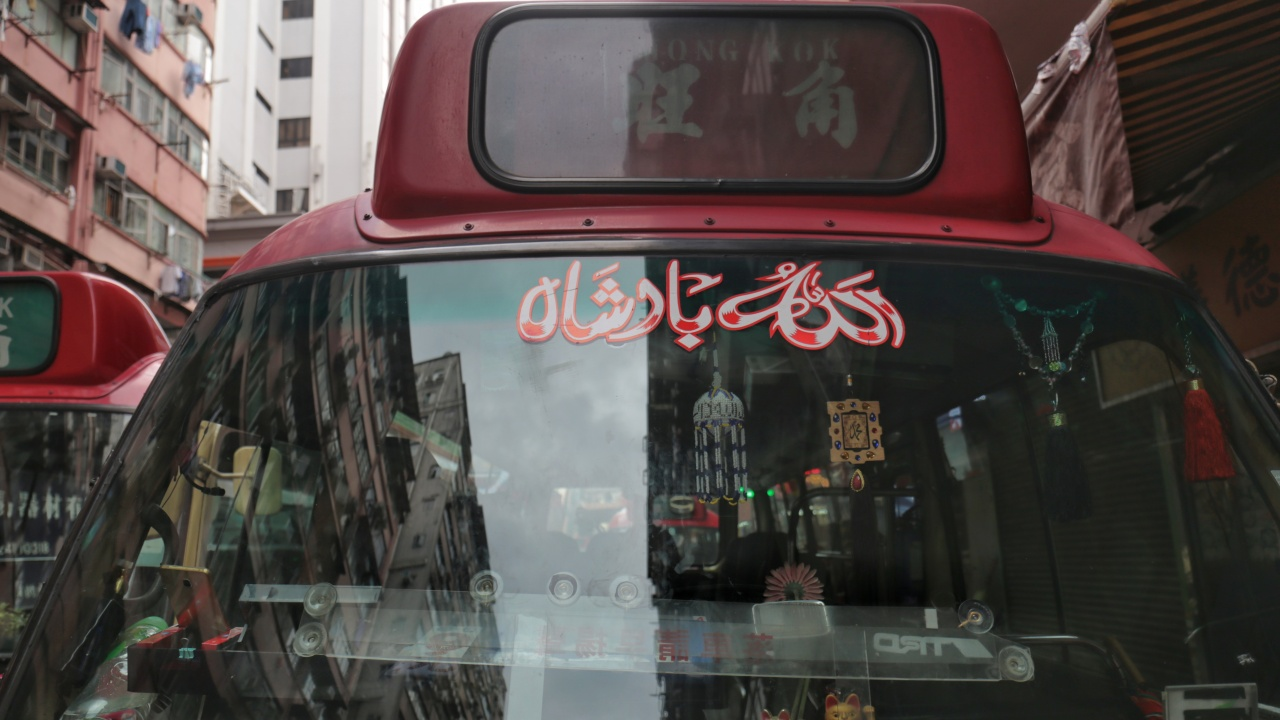 """At the front of Jony's Red Van, there is the sign """"Allah"""" (Photo by Wong Wai Man)"""